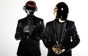 In this April 17, 2013 photo, Thomas Bangalter, left, and Guy-Manuel de Homem-Christo, from the music group Daft Punk, pose for a portrait in Los Angeles.