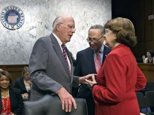Senate Judiciary Committee Chairman Patrick Leahy, left, confers with Sens. Chuck Schumer and Dianne Feinstein on Monday.