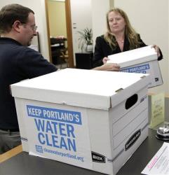 Signed petitions against fluoride are turned in at Portland's City Hall.