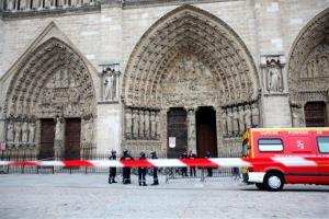 Police officers stand guard in front of Notre Dame Cathedral, in Paris, Tuesday, May 21, 2013.