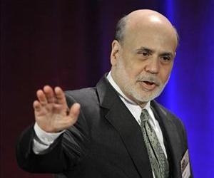Ben Bernanke waves goodbye after speaking during a banking conference in Chicago, in  this May 10, 2013 file photo.