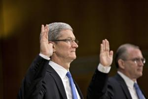 Apple CEO Tim Cook, left, and Phillip A. Bullock, right, Apple's head of tax operations, are sworn in on Capitol Hill Tuesday.
