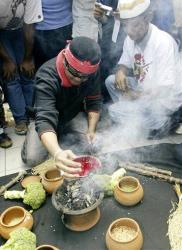 An Indonesian man prepares a black magic potion of animal blood and other ingredients in this 2006 file photo.