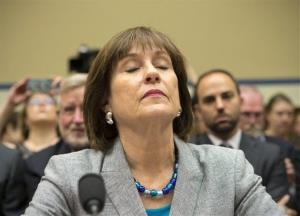 Lois Lerner, head of the IRS unit that decides whether to grant tax-exempt status to groups, listens on Capitol Hill in Washington, Wednesday, May 22, 2013.