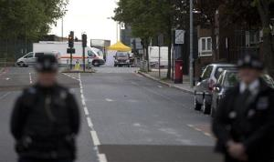 Police cordon off the scene of an attack in the London neighborhood of Woolwich.