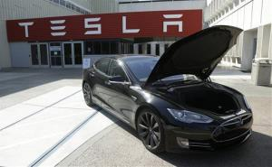 In this May 2, 2013 photo, a Tesla car is shown outside of Tesla motors in Fremont, Calif.
