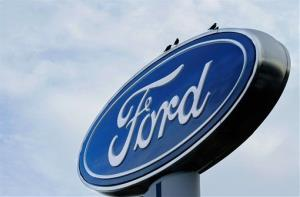 In this July 24, 2011 file photo, the Ford logo is displayed at an auto dealership.