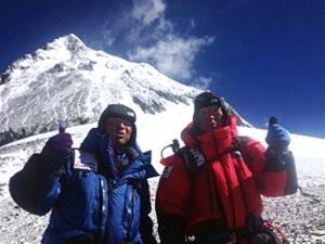 In this May 22, 2013 photo, 80-year-old Japanese extreme skier Yuichiro Miura, right, and his son, Gota pose at their South Col camp at 26,247 feet.