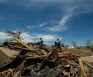 US Air Force personnel help a resident in Moore, Okla., search through the debris looking for salvageable items.