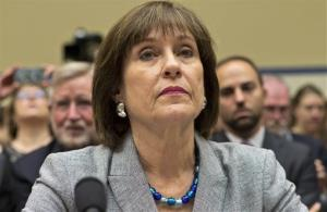 Lois Lerner, head of the IRS unit that decides whether to grant tax-exempt status to groups, appears on Capitol Hill Wednesday. She took the Fifth.