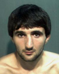 In this May 4, 2013 police mug provided by the Orange County Corrections Department in Orlando, Fla., shows Ibragim Todashev after his arrest for aggravated battery in Orlando. Todashev, who was being questioned in Orlando by authorities in the Boston bombing probe, was fatally shot Wednesday, May 22, 2013 when...