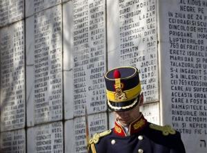 A honor guard soldier stands during a ceremony  at a Jewish cemetery in Bucharest, Romania, in 2012. The monument bears the names of those killed on the Struma.