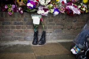 Military boots are laid in tribute outside the Woolwich miliatry barracks, near where the slaying took place.