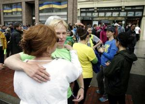 Nick Pelton of Florida hugs his mom, Colleen, at today's 'OneRun' in Boston.