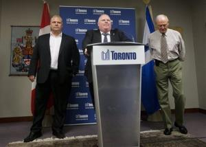 Toronto Mayor Rob Ford, center, denies that he smokes crack cocaine in a Friday news conference. At left is his brother, Doug, a city councilor, and at right is Deputy Mayor Doug Holyday.