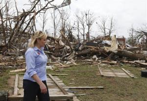 Oklahoma Gov. Mary Fallin walks through the Steelman Estates Mobile Home Park, which was hard hit in Sunday's tornado, near Shawnee, Okla., Monday, May 20, 2013.