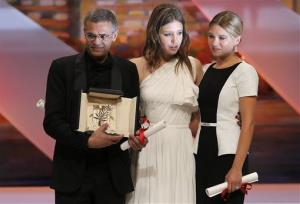 Director Abdellatif Kechiche, left, and actors Adele Exarchopoulos, centre, and Lea Seydoux react after they received the Palme d'Or award for La Vie D'Adele.