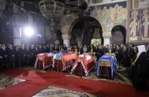 The coffins of King Peter II, second from left, his wife Queen Aleksandra, first from left, mother Queen Maria, third from left and brother Prince Andrej, are draped in Serbian royal flags.