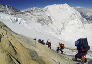 Cimbers from various countries make their way down towards Camp 4 on their way to summit Mount Everest.
