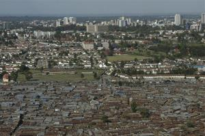 An aerial view of the slum of Kibera with the Nairobi skyline in the background in 2008.