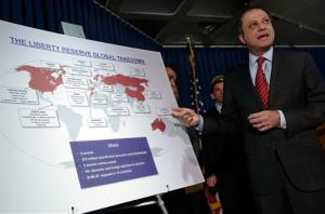 Preet Bharara, U.S. Attorney for the Southern District of New York, describes a chart showing the global interests of Liberty Reserve, during a news conference in New York, Tuesday, May 28, 2013.