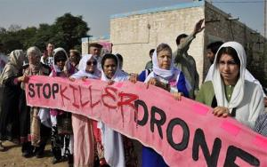 Protesters hold an anti-drone banner during a peace march in Pakistan.