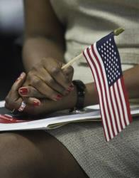 An immigrant at a naturalization ceremony.
