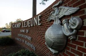 Cars enter the main gate at Camp Lejeune in Jacksonville, NC on Friday, Dec. 2, 2005.