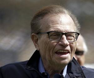 This April 1, 2013 photo shows talk show host Larry King attending a season-opening baseball game between the Los Angeles Dodgers and the San Francisco Giants.