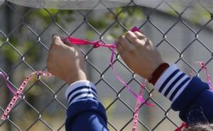 A student at Jenny Lind Elementary School ties a ribbon honoring murder victim Leila Fowler, in Valley Springs, Calif., Monday April 29, 2013.