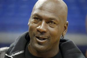 In this Oct. 2, 2012 file photo, Charlotte Bobcats owner Michael Jordan looks on after practice.