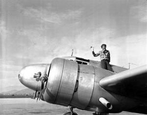 In a March 10, 1937 file photo, Amelia Earhart waves from the Electra before taking off from Los Angeles, Ca., on March 10, 1937.