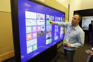 In this photo from October, Eric Havir, Microsoft's senior manager for platform strategy, demonstrates how Windows 8 apps run on an 82-inch touch-screen.