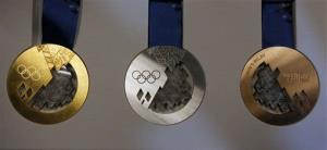 Gold, silver, and bronze medals are displayed during a presentation of Sochi 2014 Olympic medals at the SportAccord International Convention in St. Petersburg, Russia, Thursday, May 30, 2013.