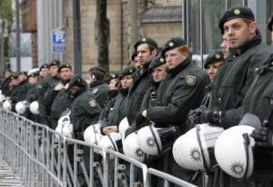 German police officers guard the Deutsche Bank building during a demonstration of some hundred anit-capitalism Blockupy protesters in front of the European Central Bank in Frankfurt.