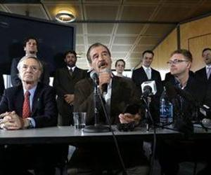 Former Mexican President Vicente Fox, center, speaks during a news conference, May 30, 2013, in Seattle, as Diego Pellicer Inc. announced its recent medical marijuana dispensary acquisitions.