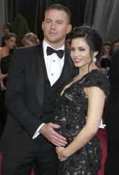 This Feb. 24, 2013 file photo shows actors Channing Tatum and his pregnant wife Jenna Dewan-Tatum at the 85th Academy Awards at the Dolby Theatre.
