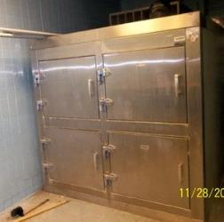 This slightly used morgue refrigerator could really tie the room together.