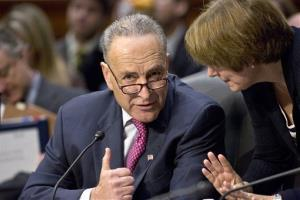 Sen. Chuck Schumer confers with Sen. Amy Klobuchar as the Senate Judiciary Committee meets on immigration reform on Capitol Hill, Thursday, May 9, 2013.