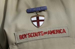 This photo taken  Monday, Feb. 4, 2013, shows a close up detail of a Boy Scout uniform worn by Brad Hankins, a campaign director for Scouts for Equality, as he responds questions during a news conference in front of the Boy Scouts of America headquarters in Irving, Texas. The Boy...