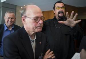 Rep. Dana Rohrabacher, left, Rep. Steven Cohen, center, and Steven Seagal, right, speak to the media in Moscow yesterday,