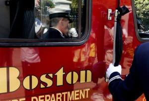 A fire engine during a funeral procession in Boston.