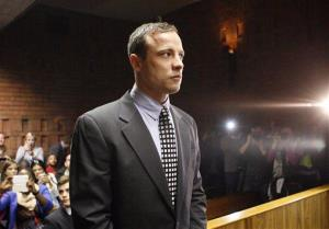 Oscar Pistorius appears in the magistrates court in Pretoria, South Africa today.