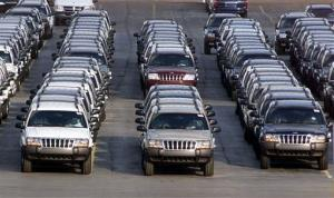 Rows of 2001 Jeep Grand Cherokees are lined up outside the Jefferson North Assembly Plant in Detroit.