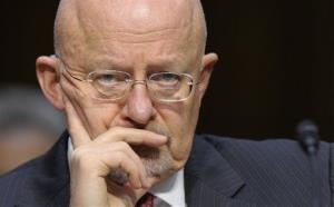 In this March 12, 2013, file photo Director of National Intelligence (DNI), James Clapper, listens to testimony at the Senate Intelligence Committee hearing on Capitol Hill in Washington.