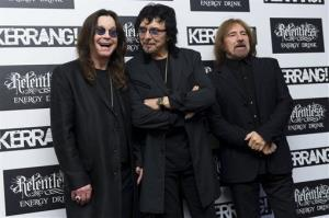 Members of Black Sabbath, from left, Ozzy Osbourne, Tony Iommi, and Geezer Butler arrive for the Kerrang Awards 2012, at a central London venue, Thursday, June 7, 2012.