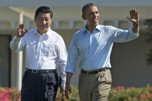 President Obama and Chinese President Xi Jinping walk at the Annenberg Retreat of the Sunnylands estate Saturday.