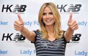Project Runway host Heidi Klum poses at the launch of her Heidi Klum for New Balance active wear collection at Lady Foot Locker on Thursday, March 14, 2013 in Culver City, Calif.