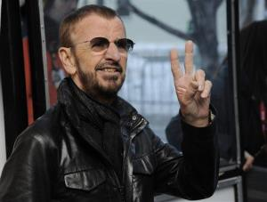 Ringo Starr flashes the peace sign for photographers in January.