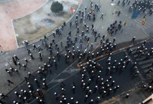 Police officers fan out at Taksim Square in Istanbul.